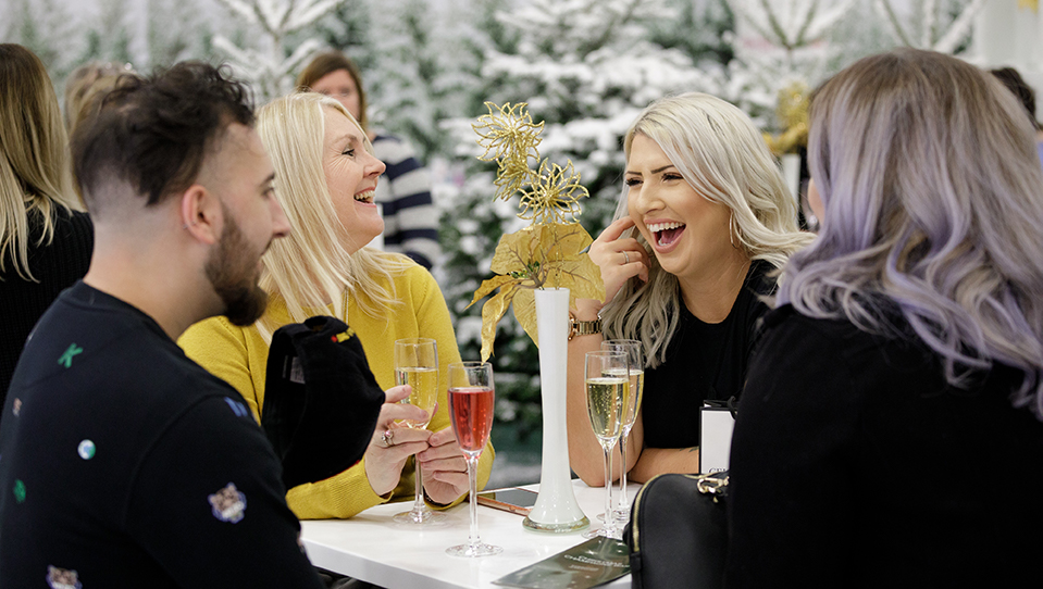 People drinking champagne at Ideal Home Show Christmas