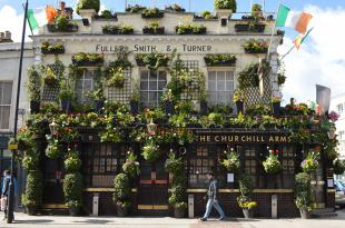 Stunning flowers decorate the Churchill Arms pub near Olympia.