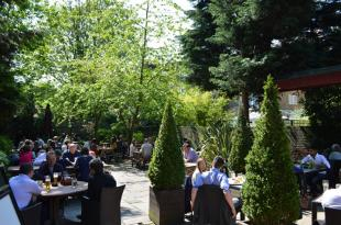 Explore the surrounding beer gardens near Olympia London in the evening